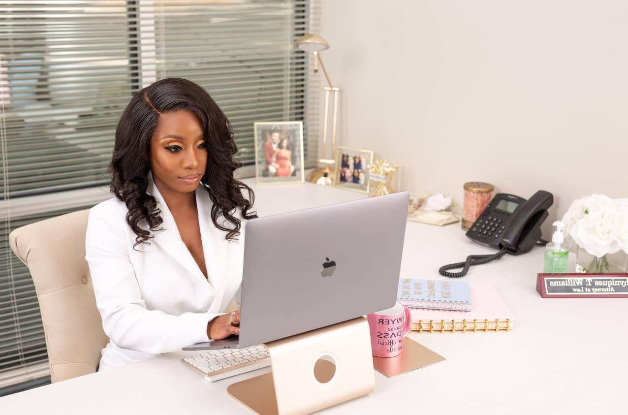 Nique Williams at desk